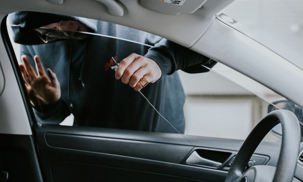 Car thefts are increasingly common in Portland—but the break-in photos in the following pages are staged. (Abby Gordon)