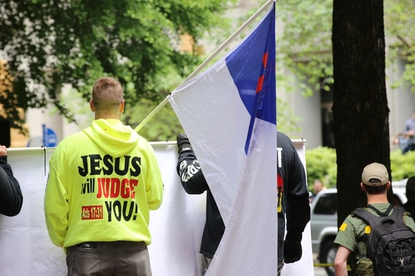 "Street preachers hold the Christian flag at a right-wing ""free speech"" rally in Terry Schrunk Plaza on June 4, 2017. (Tom Berridge)"