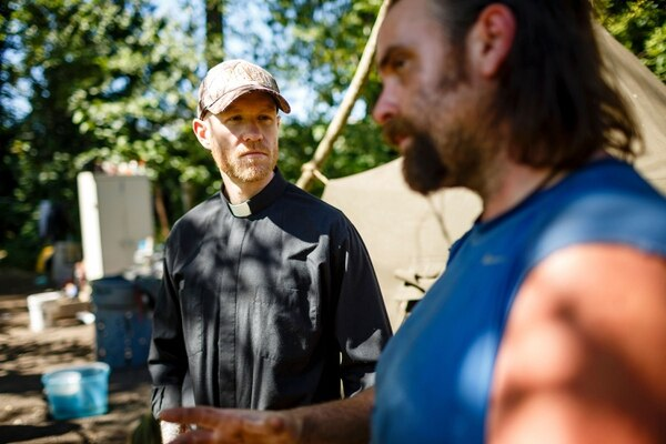The Rev. Joshua Kingsley visits Gilligan at his camp. (Christopher Onstott)
