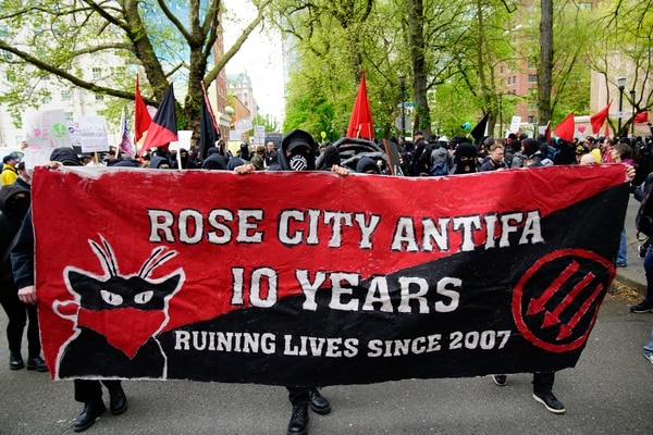 Members of Rose City Antifa marched ahead of, and blended in with, anarchist black bloc protesters on May Day. The antifa group has roots in Portland's decades-old anti-racist skinhead scene.(William Gagan)