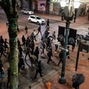 Black bloc group marches through downtown Portland on April 20, 2021. (Wesley Lapointe)