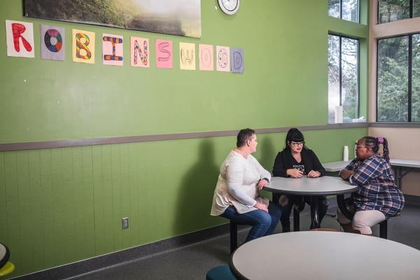 """Robinswood's brain trust found ways to soothe the anguished children in their care—including painting the walls in muted colors. """"We had to bolt all the furniture to the floor,"""" says Tabitha Jensen (center). (Will Corwin)"""
