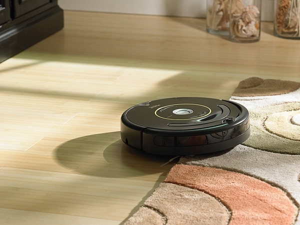 This little friend cleans your house while you're away. (Roomba)