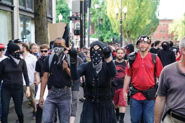 Masked demonstrators in June 2017. (William Gagan)