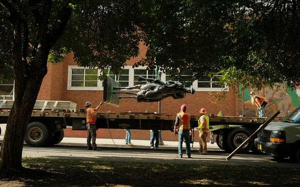 ROUGH RIDING: A statue of Theodore Roosevelt is removed from the South Park Blocks after being toppled by rioters in October. (Alex Wittwer)