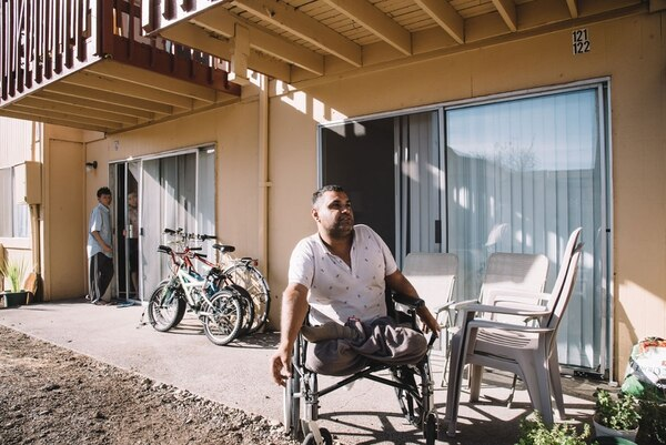 Alaa Jasim, 35, in wheelchair, is a refugee from Iraq. On a recent afternoon, he was visiting Syrian refugees who live at Barberry Village. (Joe Riedl)
