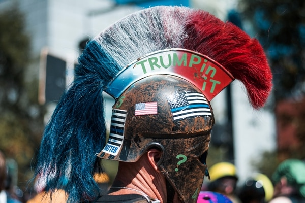 "Political allegiances at the Aug. 4 protests were conveyed through helmets, including this one worn by California resident John Turano, aka ""Based Spartan."" (Liz Allan)"