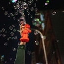A protester blows bubbles with an Elmo bubble maker on SW 3rd and Salmon St. on July 24. (Alex Wittwer)