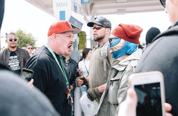 "Pro-Trump marchers faced off with antifa at Joey Gibson's April 29 protest in East Portland's Montavilla neighborhood. It was advertised as a patriotic march for ""free speech,"" but several attendees wore the insignia of racist and militia groups. (Joe Riedl)"