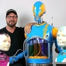 THE DROIDS YOU'RE LOOKING FOR: Will Huff poses with his robots, which can track motion and talk. (Will Huff)