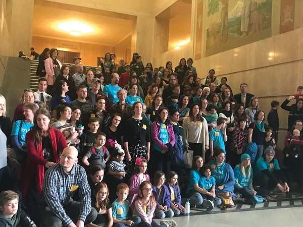 Protesters, organized by the anti-vaccine group Oregonians for Medical Freedom, sang the Star-Spangled Banner at the rotunda of the capitol on March 14. (Rachel Monahan)