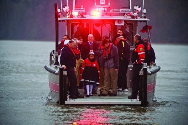 Trinity Smith, center, returned to the Willamette River on Dec. 7, 2010 to dedicate a new Fire & Rescue boat, named the Eldon Trinity.