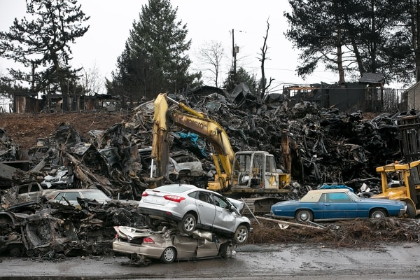 STACK 'EM HIGH: NW Metals continued bringing in junkers before cleaning up after the fire. (MULTCO COMMUNICATIONS)