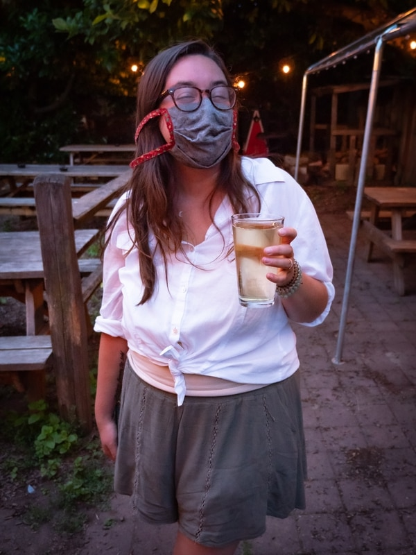 Heading to Landmark Saloon's patio, with a beer and a mask. (Brian Burk)