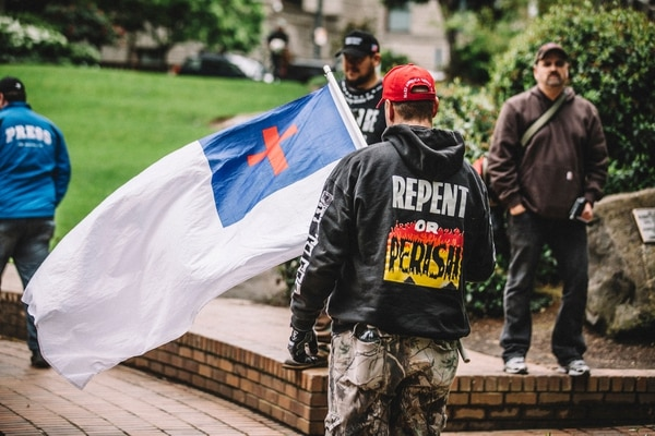 "This white flag, which flew May 13 in downtown Portland, is a symbol of the Christian Identity movement, a white supremacist theology that has been associated with the Ku Klux Klan as well as right-wing ""patriot"" militia groups. (Sam Gehrke)"