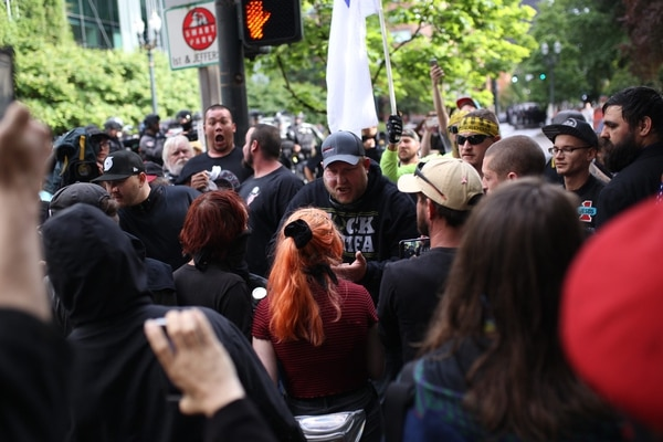 A confrontation in downtown Portland at a protest. (Christine Dong)