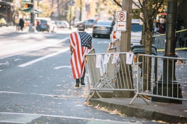 A protester strolls through downtown Portland on Nov. 17, 2018. (Sam Gehrke)