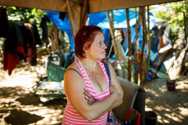 A homeless woman named Valerie Kaufman lives along Northeast Sandy Boulevard behind blackberry brambles. (Christopher Onstott)