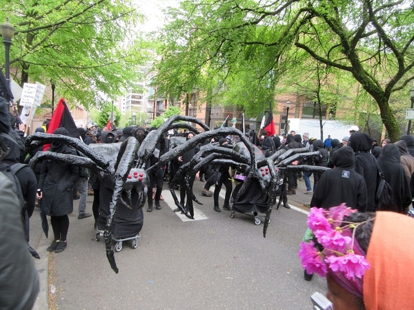 Black Block made giant spiders on shopping carts for May Day 2017 (Corey Pein).