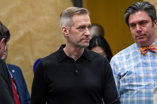 Dean Sidelinger (at right) next to Ted Wheeler at a 2020 press conference announcing COVID-19 lovcdowns. (Justin Katigbak)