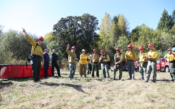 BURN BOSS: Colby Drake instructs his team at Quamash Prairie (courtesy of Metro)