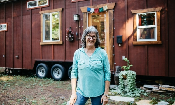 LITTLE HOUSE IN THE BIG WOODS: Dana Denny got a no-cause eviction from the Portland room she was renting. Now she lives in a little home she helped build. (Christine Dong)