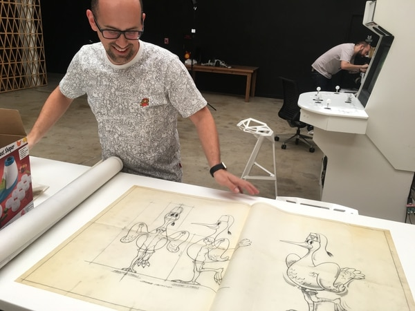 Cabel Sasser with some of Wes Cook's drawings. (WW staff)