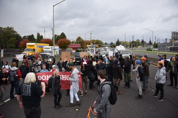 Don't Shoot Portland protesters block traffic on Oregon Route 99E during rush hour on Oct. 14, 2016. (Joe Riedl)