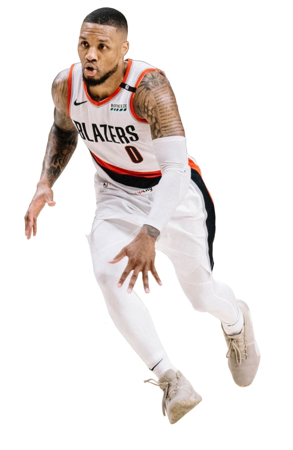 Lillard's tattoos include Psalms 37:1-3 on his left shoulder. (Sam Gehrke)