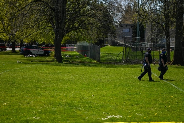 Portland police officers patrol the scene of a police shooting in Lents Park. (Justin Yau)