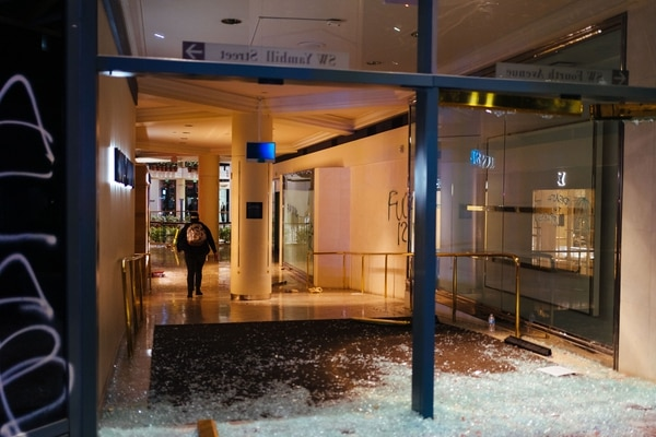 A looter enters the Pioneer Place mall. (Alex Wittwer)