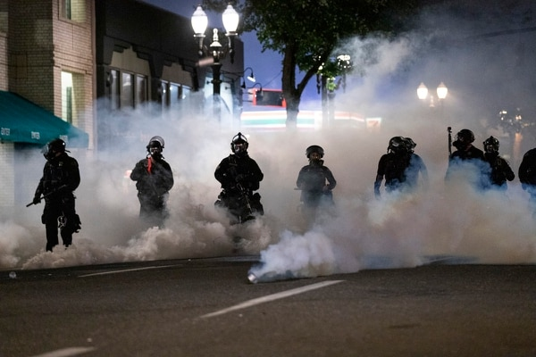 WHOSE STREETS: Portland police have used a range of crowd control devices. (Wesley Lapointe)