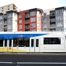 A MAX train, and housing, along the Orange Line. (TriMet)