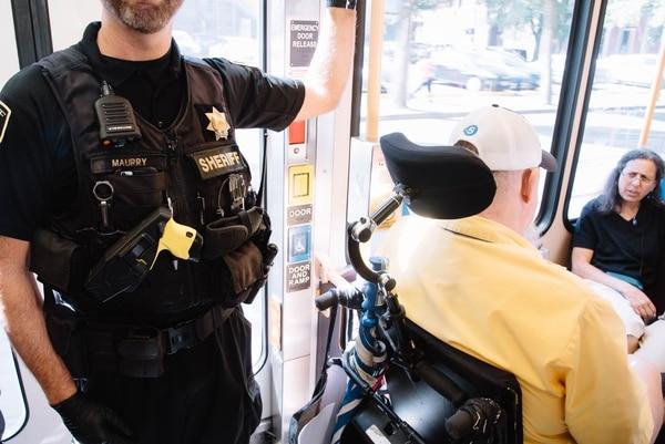 Transit police patrol a MAX train this week. (Joe Michael Riedl)
