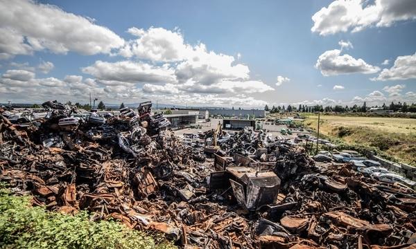 An auto scrapyard on Northeast Killingsworth Street is a moonscape of burnt metal. (Sam Gehrke)