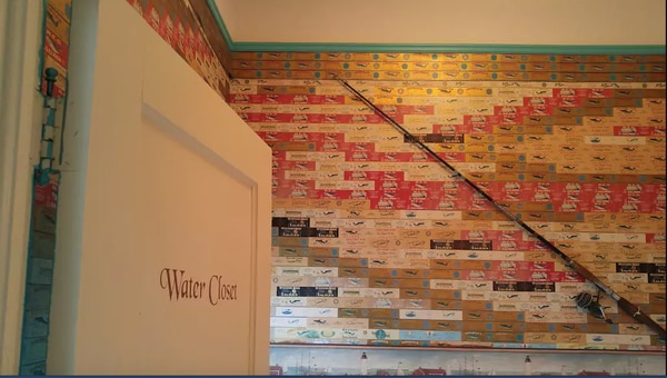 The wallpaper in the private bathroom is made up of cannery labels. (AirBnb)