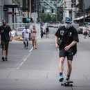 A masked skateboarder in the Pearl District in July 2020. (Brian Burk)