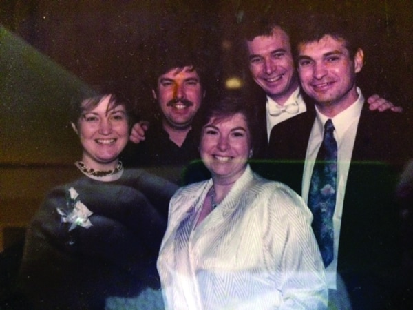 Brad Mayer is pictured before his injury–he's at far right with siblings Michelle Keyser, Paul Mayer, Stephanie Kenney and John Mayer. (Courtesy of Stephanie Kenney)