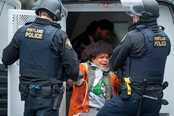 Portland Police arrest a protester on Feb. 20, 2017. (Diego G Diaz)