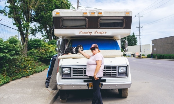 "SNOOPY COME HOME: Sheila Fitch, 57, and her dog Snoopy outside her Country Camper. ""I'm just beautiful here with my homemade stove,"" one of her favorite features on her RV. (Daniel Stindt)"