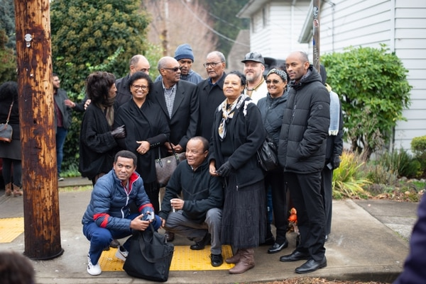 Members of the Ethiopian community gather for a photo at a memorial for Mulugeta Seraw. (Anna Del Savio)
