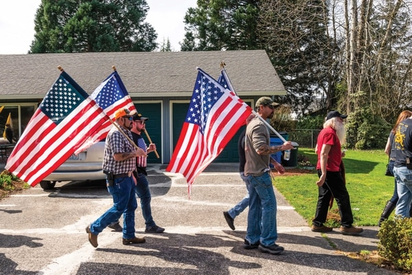 The extremely polarized debates taking place online have migrated to the streets of the Pacific Northwest, where far-right groups like Patriot Prayer march in support of gun ownership and interrupt vigils for victims of police shootings. (Justin Katigbak)