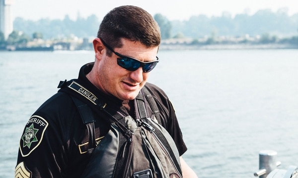 """River Patrol Sgt. Stephen Dangler hauls bodies from the water. """"It happens more than you'd ever imagine,"""" he says. (Daniel Stindt)"""