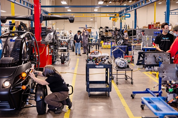 """The Arcimoto factory employs 60 people, and is chock full of high-tech gear, including two robots named """"Domo"""" and """"Arigato"""" and a state-of-the-art metal lathe they call Kenny G. Frohnmayer hopes to replicate the factory at locations all over the world after perfecting it in Eugene. (Wesley Lapointe)"""