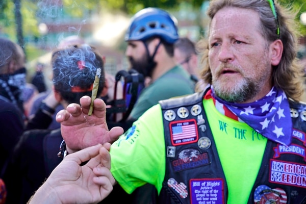 Alt-right and leftist anarchists share a weed blunt. (William Gagan)