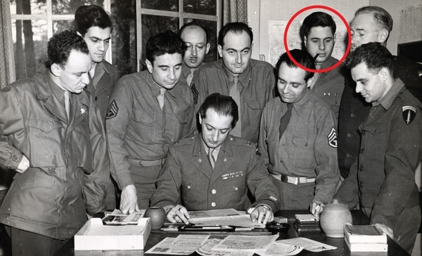 """Glorious Basterds: This photo, taken in Luxembourg in 1945, shows some of the """"Psycho Boys""""—European refugees trained in psychological warfare and counterintelligence at Camp Sharpe, Pa., by Hans Habe, the flamboyant Austrian writer-turned-American spy. Habe is seated. Peter Wyden, with pipe, stands third from right. (© United States Holocaust Memorial Museum)"""