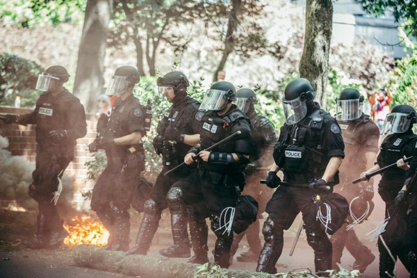 Shortly after 2 pm, police advanced on the left-wing protesters, marching past foliage set aflame by munitions. (Sam Gehrke)