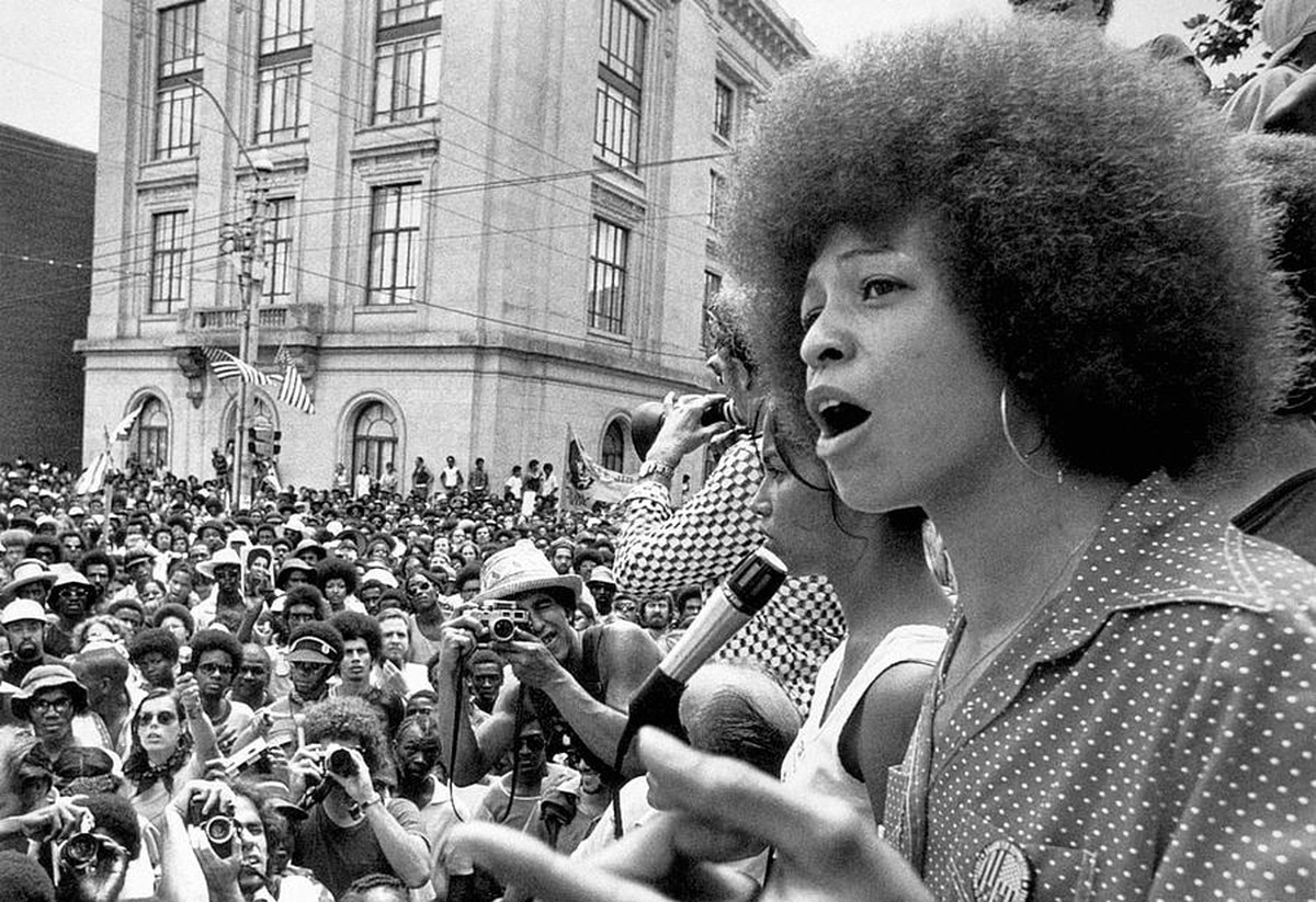 photograph of Angela Davis speaking at a political rally in Raleigh, NC in 1974
