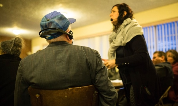 Tatyana Bobrick translates for Russian and Ukrainian renters at a recent tenant meeting. (Walker Stockly)
