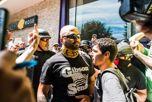 Patriot Prayer leader Joey Gibson led a small troop of followers into a crowd of antifascists, who promptly pushed them toward the police line, but not without landing a few punches. (Justin Katigbak)